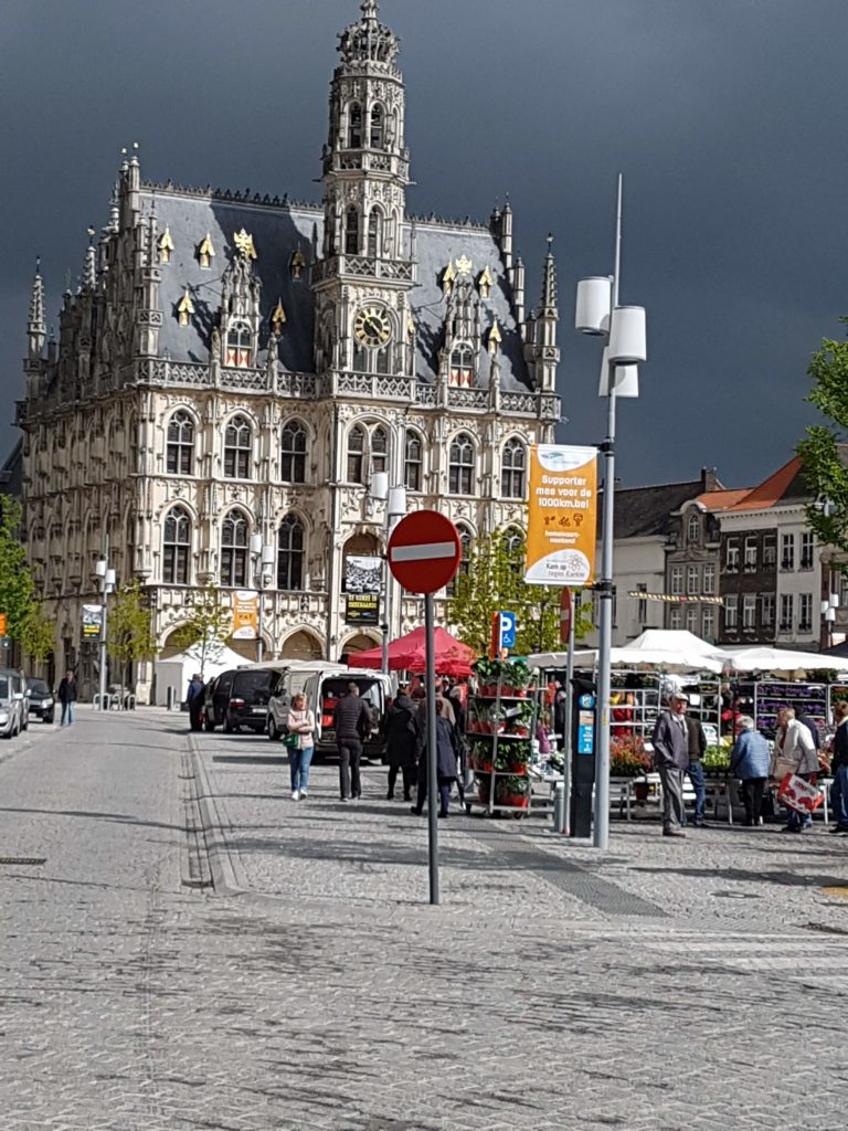 13th Century Cloth Hall in Oudenaarde and flower market